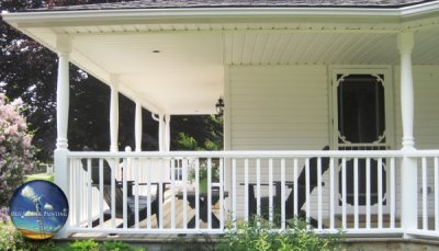 Spacious wrap around porch/deck refinished in sparkling clean white for this home