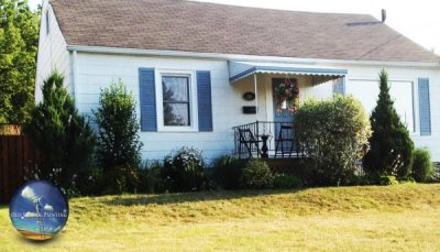 Homeowner goes for clean, white exterior finish, no more dark and dreary